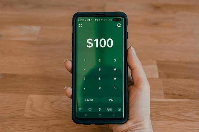 Client transferring money through a mobile telephone